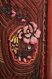 """Embroidered detail of a costume from the British television drama """"Downton Abbey"""" at the Winterthur Museum in Wilmington, Del. The exhibit, which opens Saturday and runs through January 2015, will offer visitors a firsthand look at the design and creation of the period fashions that are a focal point of the television show, in the context of comparing country house life in Britain and the United States.Jennifer Corbett  -  AP"""