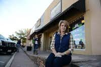 Christi Foster, owner of Groovy's in downtown Rockwall and president of the Rockwall Downtown Merchants Association, sits outside her shop on East Rusk Street. In the coming weeks, the city will begin Phase II of its $8.6 million bond project to revitalize downtown.(Rose Baca)
