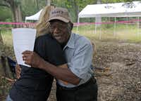 University of South Florida assistant professor Erin Kimmerle hugs Elmore Bryant at the Boot Hill cemetery, where a team of anthropologists from the school has been exhuming remains. The cemetery is at the now-closed Arthur G. Dozier School for Boys in Marianna, Fla.