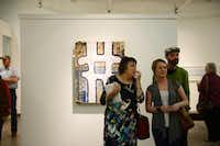 Family members of artist Jay Hendrick   Karen Hendrick (from left), Alana Hendrick and Joel Hendrick   look at art at the Cohn Drennan Contemporary gallery on Dragon Street during the design district's art walk Jan. 11. Art lovers and novices alike are trekking to explore the many galleries that have popped up there in about the last 10 years.ROSE BACA