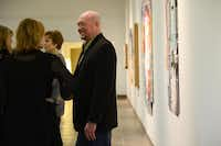 Cohn Drennan chats with patrons at his gallery on Dragon Street during the design district's art walk Jan. 11. Art lovers and novices alike are trekking to explore the many galleries that have popped up there in about the last 10 years.ROSE BACA