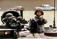 The image of the helmeted Michael Dukakis proved to be the ultimate in what not to wear for presidential candidates. (File)