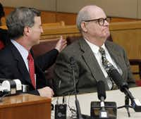 Dale Lincoln Duke (right) and his attorney, Robert Udashen, hear Judge Susan Hawk tell him he's a free man after 14 years spent in prison.