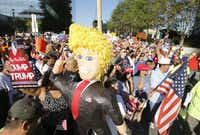 Protesters hoisted a Donald Trump piñata during a march last September to American Airlines Center from the Cathedral Shrine of Our Lady of Guadalupe. (2015 File Photo)