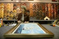 Designer Gwen Bell cleans a frame at the Dutch Art Gallery in Lake Highlands.Rose Baca  - neighborsgo staff photographer