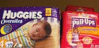 File photo, packages of Huggies and Pull-Ups, both Kimberly-Clark brands, are displayed at a store in San Francisco.