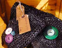 Old video and audio tapes are woveninto a purse. These sell for about $19.50 at Kiss The Frog Again in Bath, England.