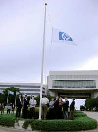 Executives of Hewlett-Packard and EDS raised the HP flag over the former EDS headquarters in Plano on Sept. 23, 2009, in honor of EDS' new name:  HP Enterprise Services.