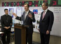 "Sen. Dan Patrick (center), who visited an Austin school with Lt. Gov. David Dewhurst in December, now says his rival ""has become an excuse machine in the last two months."""