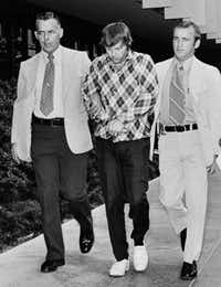 Edward C. Allaway (center) is escorted into the Orange County (Calif.) courthouse on July 14, 1976. Allway was found not guilty by reason of insanity in a July 12, 1976, shooting spree that left seven people dead at Cal State Fullerton.