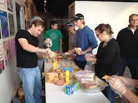 Members of the East Dallas Young Professionals  prepare sandwiches at the SoupMobile during a November service day. The group made more than 3,000 sandwiches.( Photo submitted by EAST DALLAS YOUNG PROFESSIONALS )