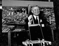 Elvis Mason, CEO of InterFirst Corp. and the big green building's biggest champion, presided over the groundbreaking of InterFirst Plaza on March 3, 1983. The 72-story tower (next to his head) was superimposed on the Dallas skyline, which had few of today's landmarks.( Joe Laird  -  Staff Photographer )