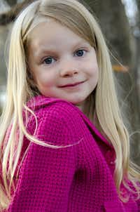 This 2012 photo provided by the family shows Emilie Alice Parker. Parker was killed Friday, Dec. 14, 2012, when a gunman opened fire at Sandy Hook elementary school in Newtown, Conn., killing 26 children and adults at the school. (AP Photo/Courtesy of the Parker Family) 12162012xNEWS