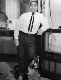 Emmett Till, in his home in Chicago, about six months before he was killed in August, 1955, while visiting relatives in Mississippi. The 14-year-old Chicago boy's death was a catalyst for the civil rights movement. Two white men charged in the killing, Roy Bryant and his half-brother, J.W. Milam, were acquitted by an all-white jury. They confessed to the killing in a 1956