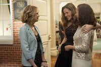 Annie (Kristen Wiig), left, puts up with Helen (Rose Byrne), center, because of Lillian (Maya Rudolph).