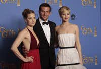 Amy Adams, Bradley Cooper, and Jennifer Lawrence backstage at the 71st Annual Golden Globe Awards show at the Beverly Hilton Hotel on Sunday, Jan. 12, 2014, in Beverly Hills, Calif.(Lawrence K. Ho - MCT)