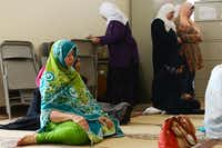 Saba Hassan, a member of the East Plano Islamic Center, prays inside the current facility. The center, which functions as a mosque and also provides social services to the community, has begun work on a 33,000 square-foot facility, but leaders are still looking for donations to complete the project.(Rose Baca - neighborsgo staff photographer)