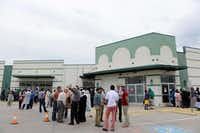 Members of the East Plano Islamic Center congregate outside the current facility following an afternoon prayer session.Rose Baca - neighborsgo staff photographer