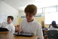 Cooper Newsom works on his iPad during Adam Willis' seventh-grade science class. Willis incorporates the use of iPads into many lessons at Episcopal School of Dallas. The school is making an effort and joining other private schools and school districts in getting technology used in the classroom.