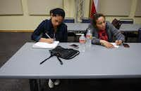 ESL students (from left) Ana Ramirez and Nora Sanchez do a word problem in English at the Farmers Branch Manske Library on March 20, 2014. The 20-year-old program has reached as high as 80 students a night, though lately its plateaued to 20 to 30.Rose Baca - neighborsgo staff photographer