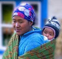 Sherpani and child on the trail to Everest.John Flinn