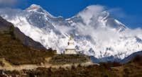 A Tibetan Buddhist chorten on the trail to Mount Everest. The world's highest peak is visible in the upper left hand corner of the photo.John Flinn