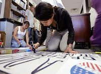 As a sophomore at Yvonne A. Ewell Townview Center in 2006, Girsea Martinez worked on a poster in the days leading up to a massive pro-immigration march in Dallas.(File Photo -  Staff )