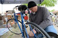 "Bike Irving co-founder Dave Vest repairs a donated bike during ""Wrench Day.""(Rose Baca - neighborsgo staff photographer)"