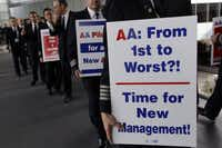 American Airlines pilots marched in September at O'Hare International Airport in Chicago to protest benefit cuts as the Fort Worth-based carrier goes through bankruptcy.