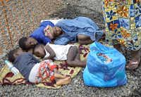 Children in Monrovia, Liberia, lay on the ground Thursday while waiting to be admitted to an Ebola treatment center operated by Doctors Without Borders. They were brought to the center by ambulance from an Ebola isolation center that had been overrun by a mob.John Moore  -  Getty Images