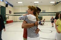 Fifth grade teacher Jennifer Novak-Martellotto hugs former student and graduating senior Riki Shah during a reunion with former teachers and students at Mathews Elementary School in Plano. As part of a district tradition that goes back more than 25 years, seniors attended elementary school reunions throughout May that allow them to reconnect with former teachers and friends just weeks before their graduations.( Rose Baca  -  neighborsgo staff photographer )