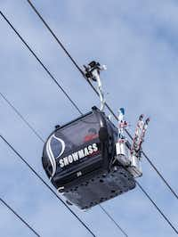 A gondola car carries skiers to Elk Camp. Sprawling over 3,332 acres, Snowmass is the second largest ski resort in Colorado.