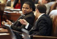 State Rep. Eric Johnson, D-Dallas, left, and State Rep. Lance Gooden, R-Terrell, converse during the session of the Texas House of Representatives, 83rd Legislative Session, in Austin on Wednesday, January 9, 2013.