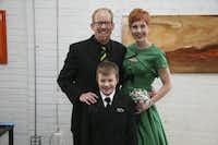 Brad &; Natalie Jackson on their wedding day with son Caleb.