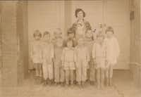 The book includes this photo, of teacher Vivian Field, for whom Vivian Field Middle School in Farmers Branch is named, and her class in 1927. George Dennis Jr. is third from the right.