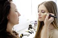 Makeup artist Ashley Robinson, left, and model Remy Ryan, preparing for the photo shoot.