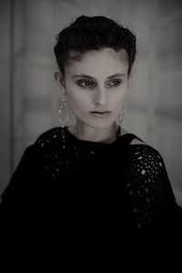 Chanel one shoulder knit dress, $3,555, and capelet, $3,565, Chanel, Highland Park Village; Chanel gladiator sandals, $1,295, Neiman Marcus, NorthPark Center; Sylva & Cie jade and diamond earrings, $12,125, Stanley Korshak
