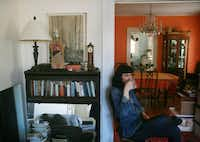 """BODIES AT REST: Art historian and gallery owner Cris Worley — the house is hers — drinks from another mug entirely. On the bookshelf, a biological model Swenson unpacked when he moved in. """"I hated that thing at first,"""" Worley says, but she's made peace with it. Swenson's father was a colonel in the Army Nurse Corps during the Korean War. """"He saw the worst injuries,"""" Worley says. Hence, one could surmise, Swenson's fascination with blood, gore, forensics, struggle and war — """"the idea of the things his dad saw,"""" says Worley — all themes in his work."""