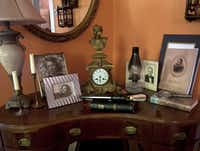 """Of the four photos on the antique desk, three are Worley's: her grandmother, mother and father. The fourth photo is Swenson's, of Gen. Joshua Chamberlain, whom Swenson admires greatly. Worley and Swenson once visited Chamberlain's house in Brunswick, Maine. """"Erick was so excited."""""""