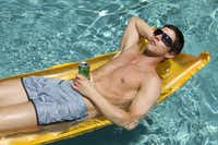 Gucci sunglasses, $235; Prada nylon swim trunks, $295, both Neiman Marcus(STEVE WRUBEL)