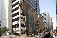 An 18-wheel flatbed truck arrives, mosaics in tow, to the Joule construction site on Commerce Street. Getting there was no easy task: A special route was mapped by Van Enter and architect Jay Firshing to specifically avoid low overpasses, sharp turns, bumpy roads and low-hanging trees.