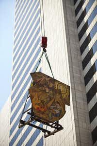 Six years after being rescued from the Mercantile Bank complex, a mosaic is moved into the under-construction Joule hotel.