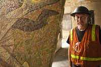 The art conservator Michael Van Enter on-site at the Joule Dallas hotel during the first mosaics' move into the new building. During the next seven months, 73 mosaics will be transported from a warehouse to the expanded Joule.