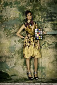 Rodarte marigold and ochre metallic cotton and transparent silk satin drop waist and off the shoulder sun spot dress, metallic navy draped leather and swarovski elements pixelated sandals, bu Burak Uyan for Rodarte. Price upon request, available through Barneys NY. Carolyn Roumeguere horn cuff with vermeil wings, $850, Grange Hall. . Lydia Courteille owl ring in blackened white gold, crystal, sapphire and diamonds, $51, 744.00, Grange HallTHOM JACKSON