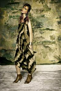 Michael Kors olive/sage sabora print striped chiffon scarf dress, $2995, Neiman Marcus NorthPark. Jody Candrian hammered brass cuff, $925, Forty Five Ten. Givenchy camel leather open toe with gold strap heels, $1370, Neiman Marcus NorthPark.(THOM JACKSON)