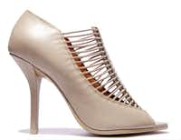 Givenchy Elastic Cage Bootie, $750, Neiman Marcus downtown, 214-741-6911, neimanmarcus.com