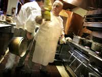 Executive chef Jean LaFont (right) and chef Mark Moberly cross paths in the kitchen of restaurateur Alberto Lombardi's French Bistro, Toulouse Cafe and Bar August 2005.