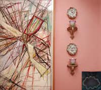 In Blake's pink boudoir, antique porcelains sidle up to a James Biederman painting