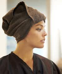 Tara Tonini with a towel on her haid.