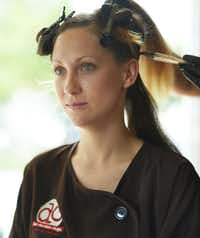 Tiffany Hicks with clips in her hair as color is applied.